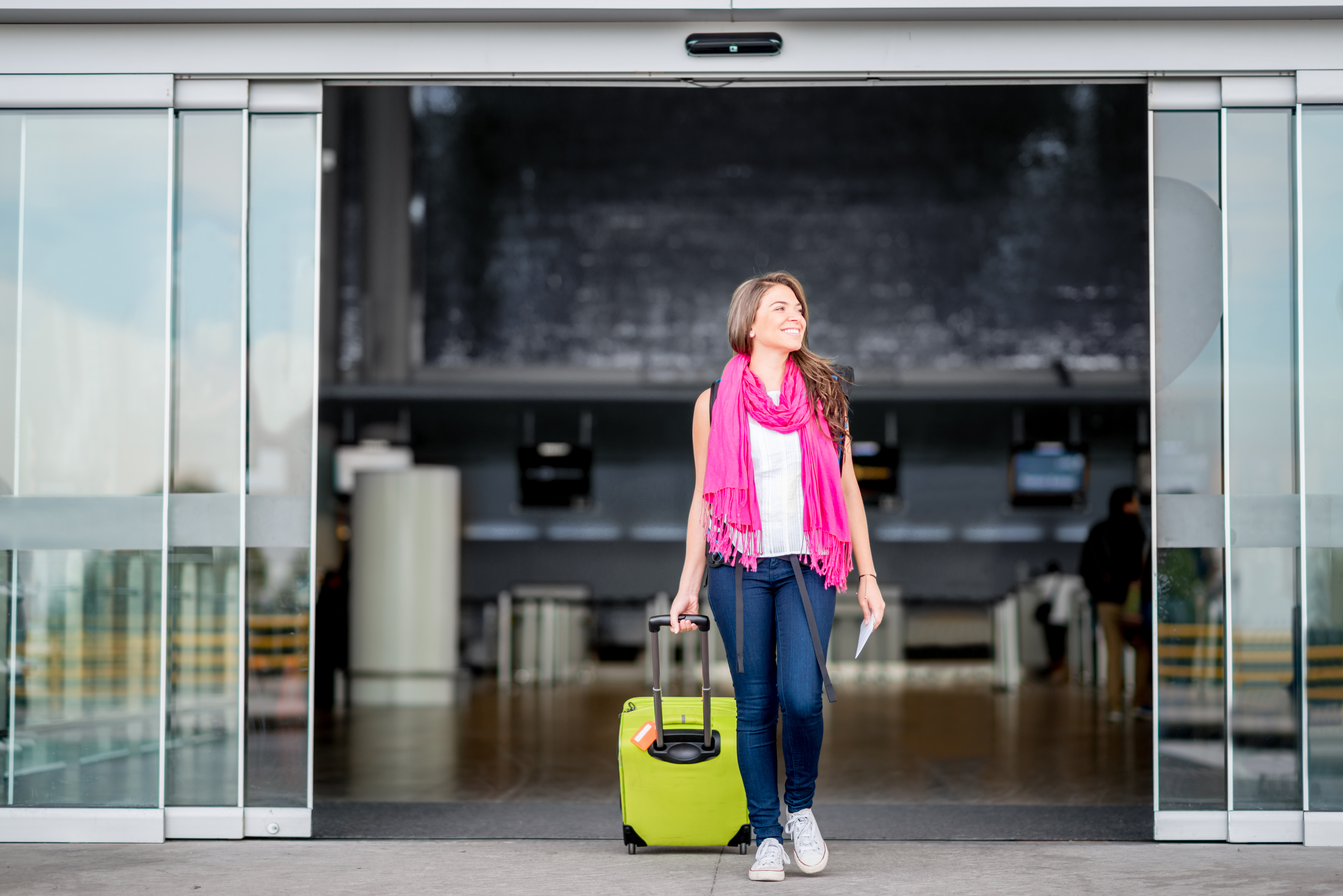 Woman traveling from the airport and holding bag